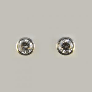 Cercei cu diamante rotunde