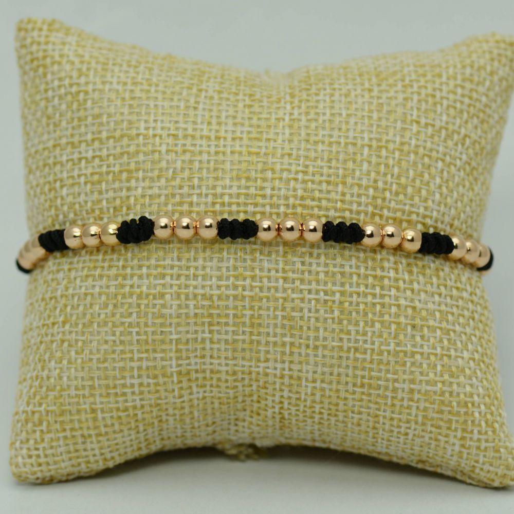 Bratara de aur roz 18k cu fir textil negru